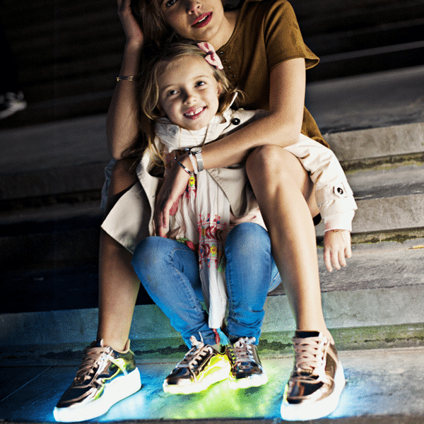 Alternative image of the rose gold shoes for girls and women, with their lights on.
