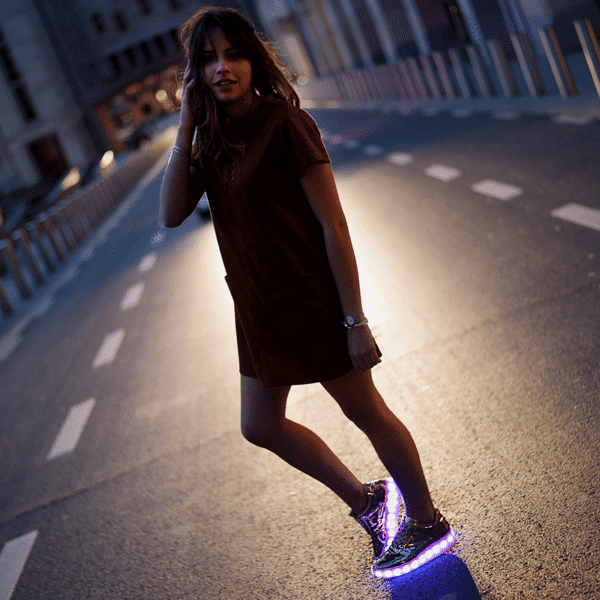 Alternative image of the rose gold shoes for women, with its lights on.